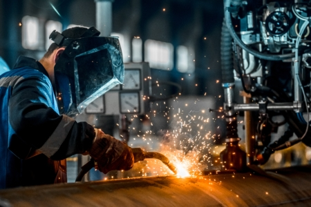 Choosing a Metal Fabrication Company Man Welding